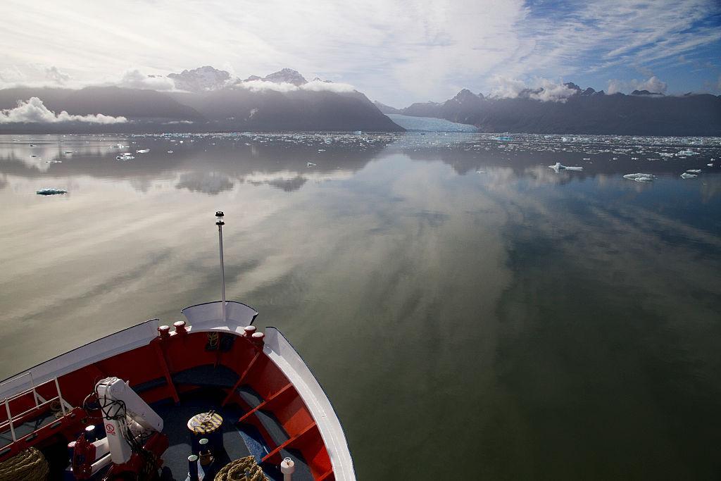 Fishermen approach glacier