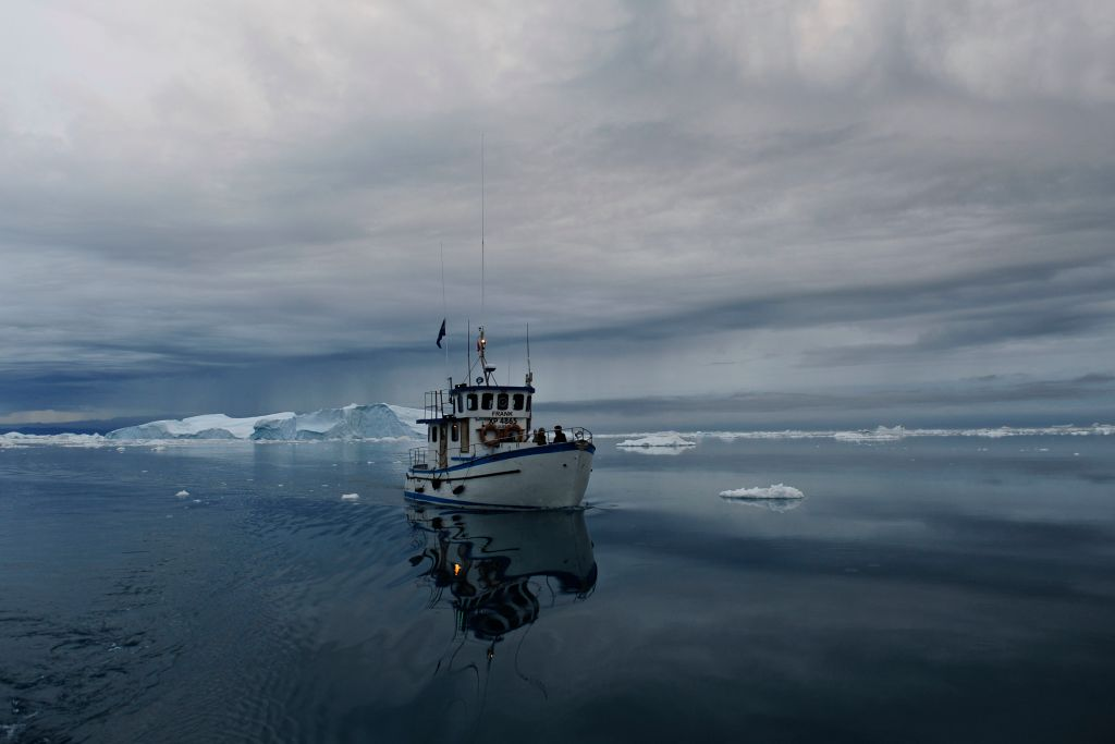 chasing glaciers in dangerous conditions to save an animal