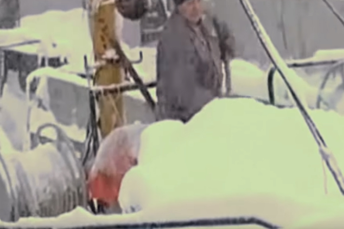 russian sailor moving boat closer