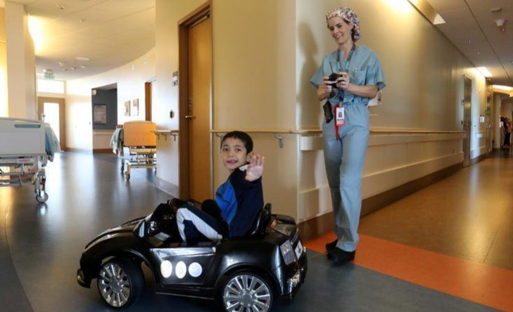 Driving mini cars in childrens hospital