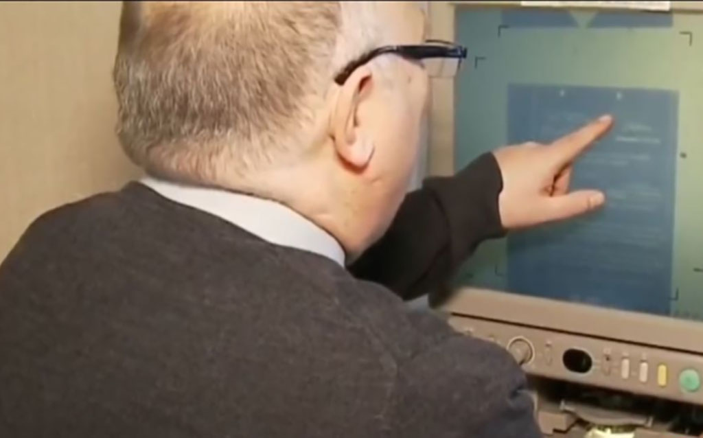 Mark Askins pointing at a computer scree