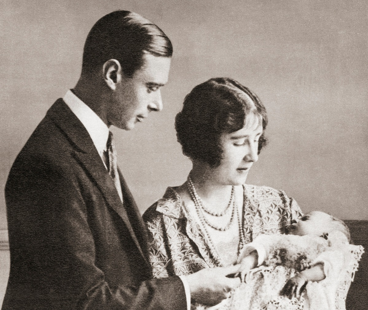 King George VI and Duchess of York christening Princess Elizabeth in 1926.