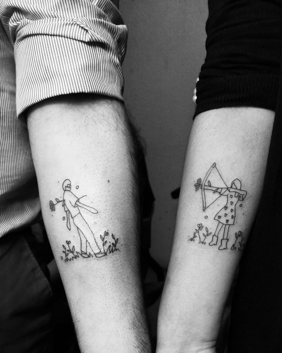 matching tattoo of woman shooting cupids arrow at man