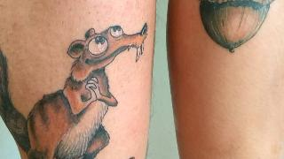 tattoos of squirrel from ice age and the nut it chases