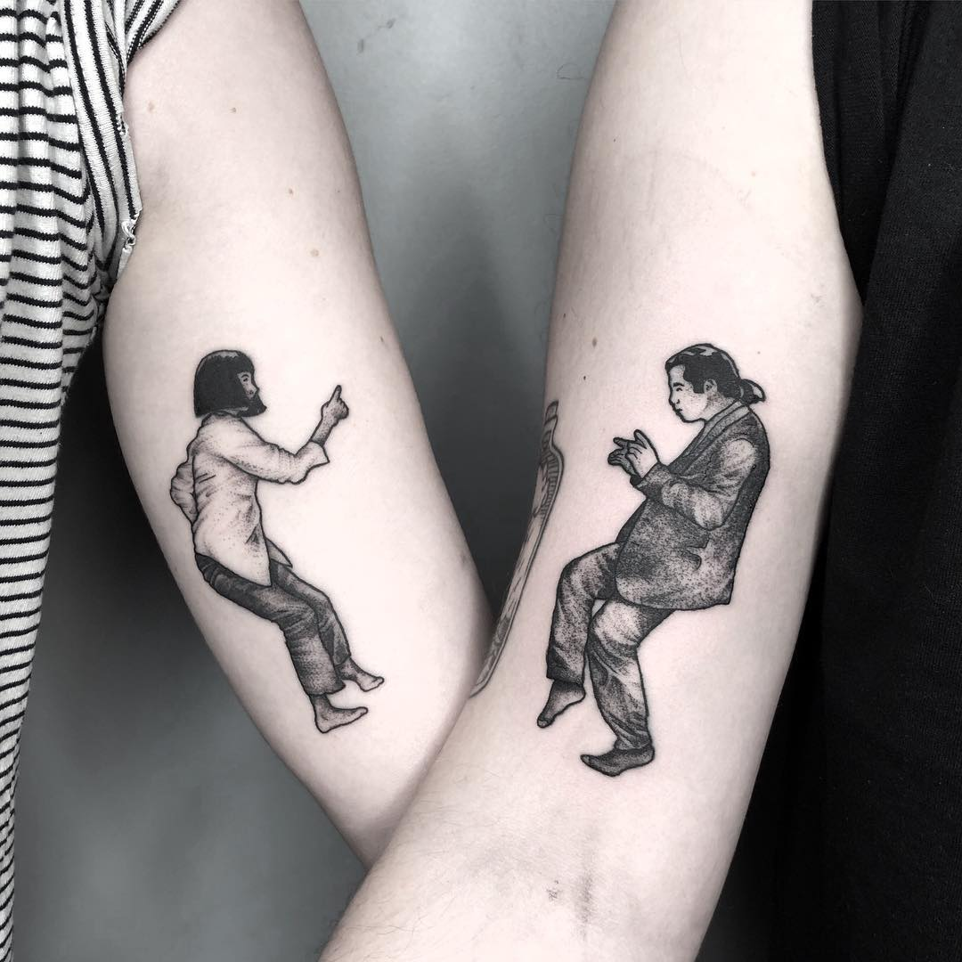 matching tattoo of pulp fiction dancing together