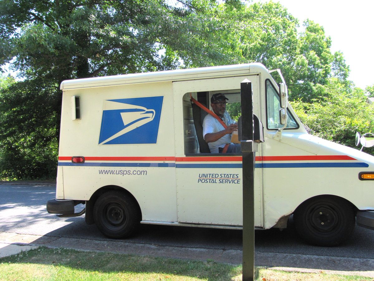 floyd martin in his usps postal truck