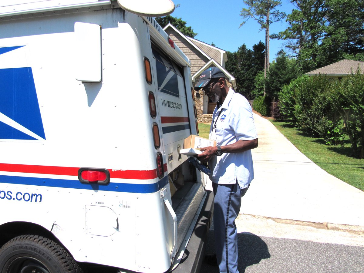 floyd getting mail from back of truck