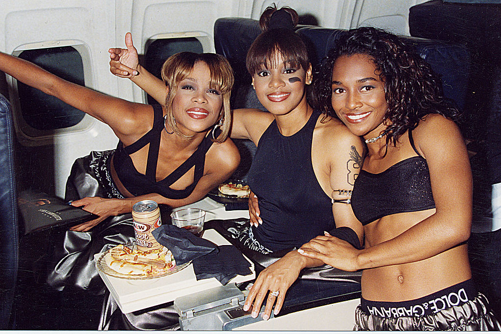 TLC on a lounge area of plane in 1995