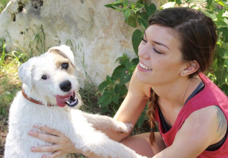 woman holding terrier