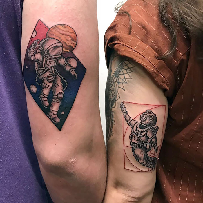 astronaut and deep sea diver on back of arms