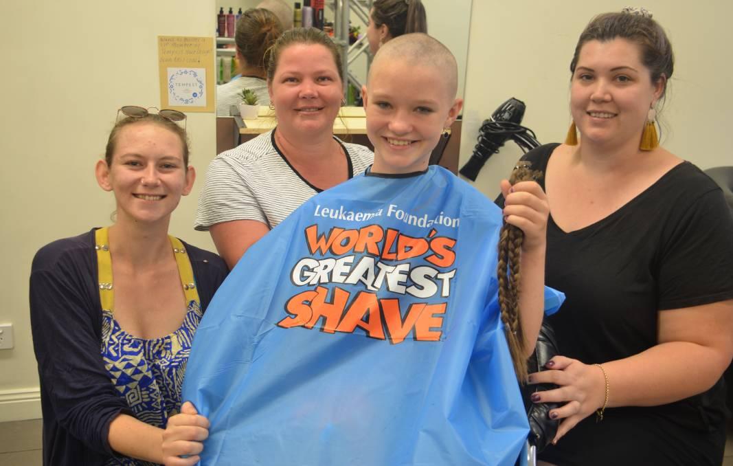 shaved head with family Kyarah Doyle