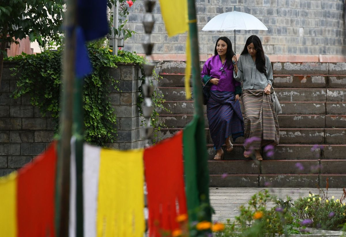 bhutan rain to women umbrella