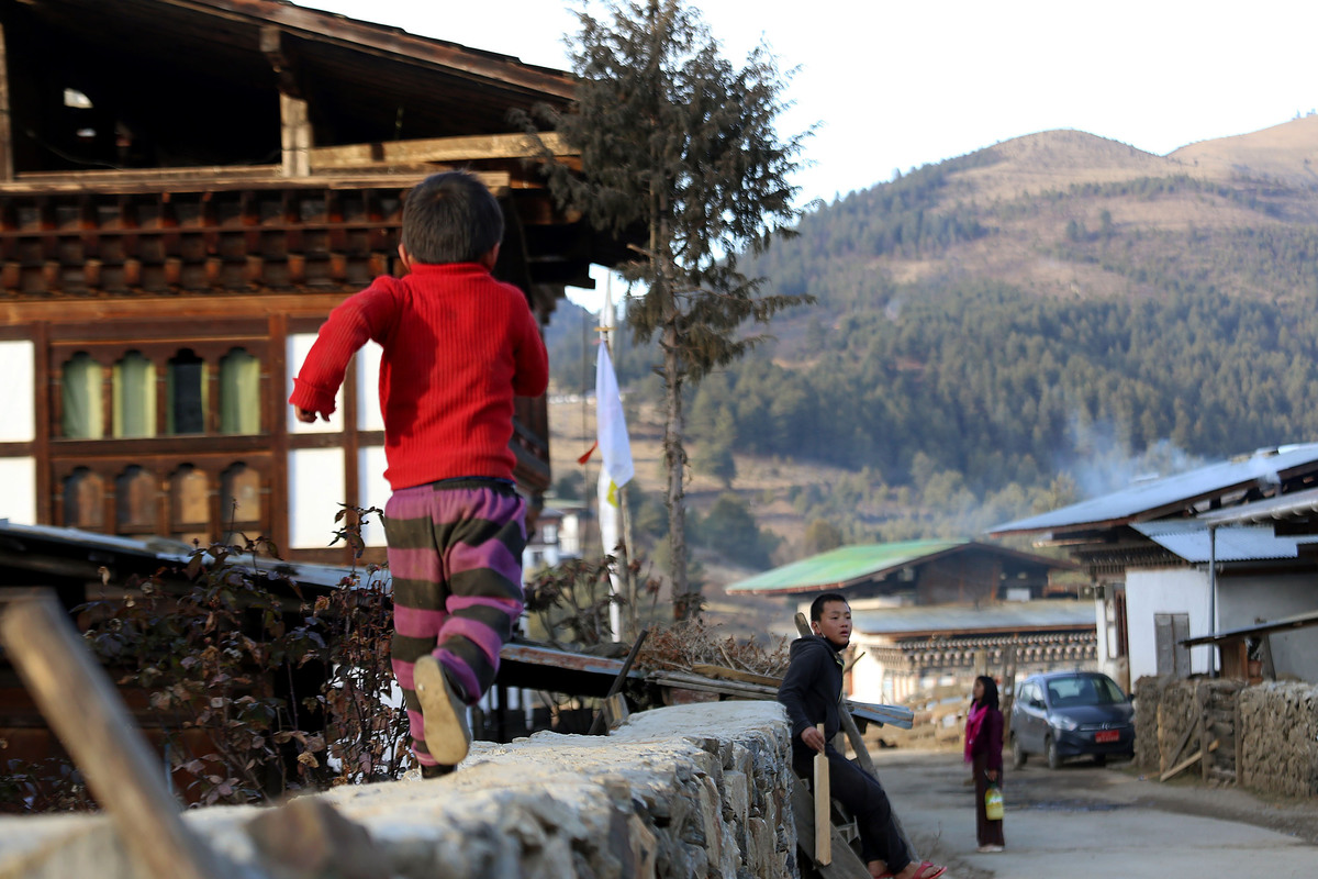 Daily Life In Bhutan kid running wall country mountain