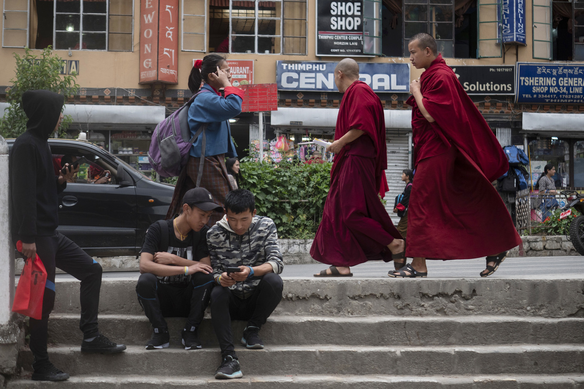 Changing Face Of Bhutan city streets monks walking