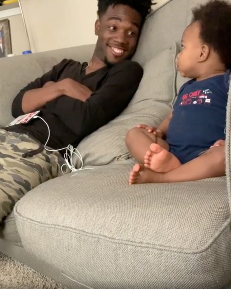 DJ and kingston looking at each other and laughing