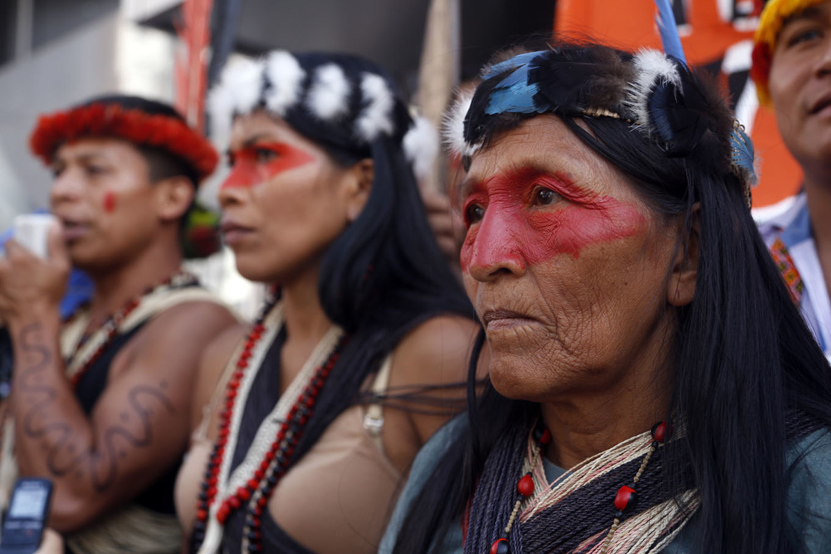 close up shot of Waorani indigenous people protesting outside ministry of natural resources