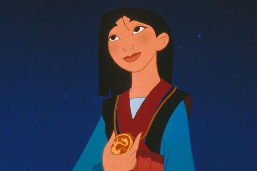 mulan disney princess holding medal as hero of china at end of movie