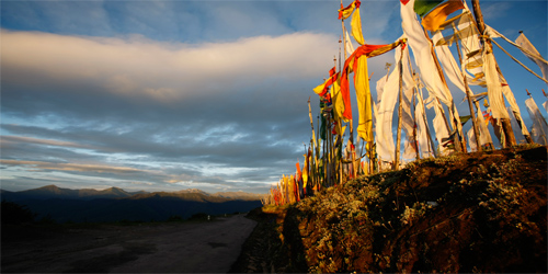 bhutan funeral flags mountain