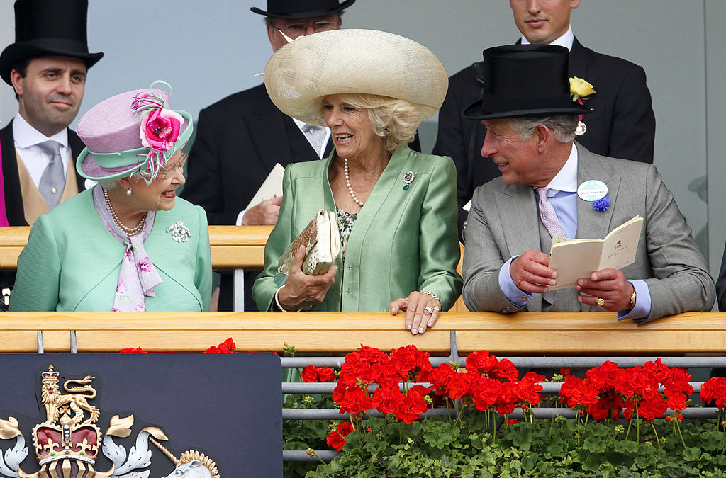 Queen Elizabeth II, Camilla, Duchess of Cornwall and Prince Charles, Prince of Wales watch the horses in the parade ring as they attend Day 2 of Royal Ascot at Ascot Racecourse on June 19, 2013 in Ascot, England-170876883