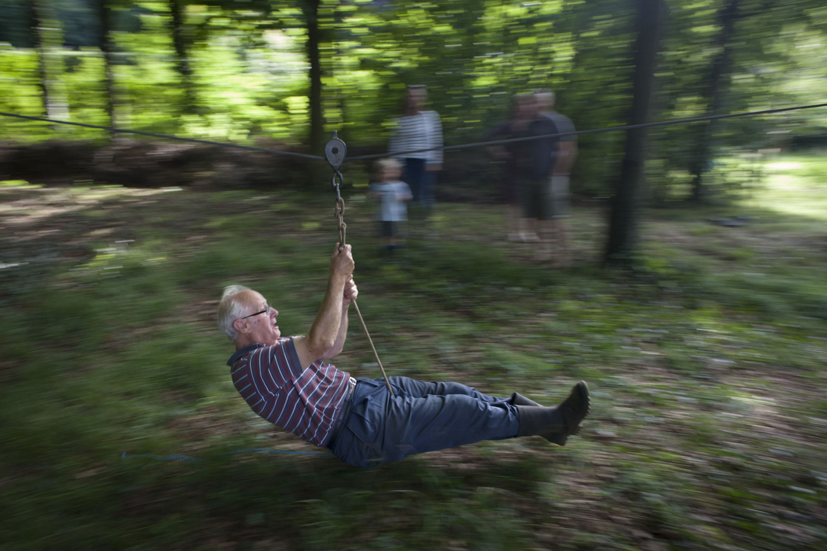 pensioner using homemade zip line in Somerset