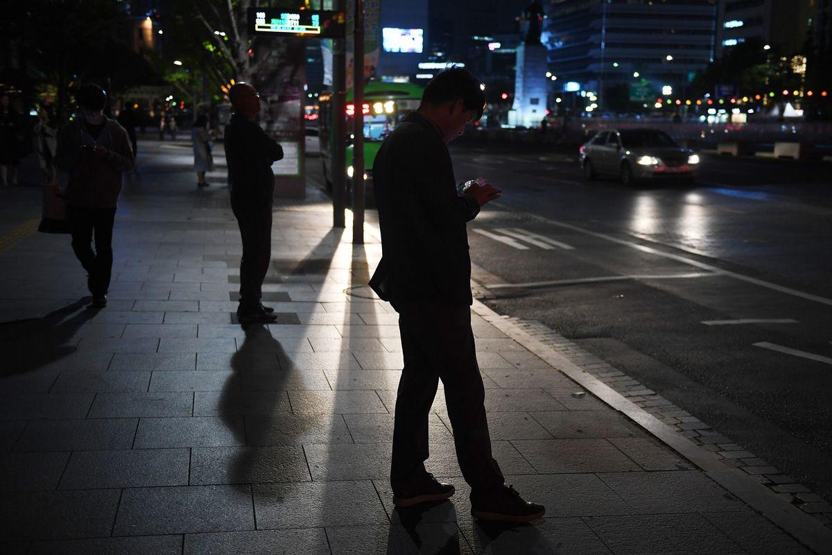 seoul korea nighttime waiting for public transit