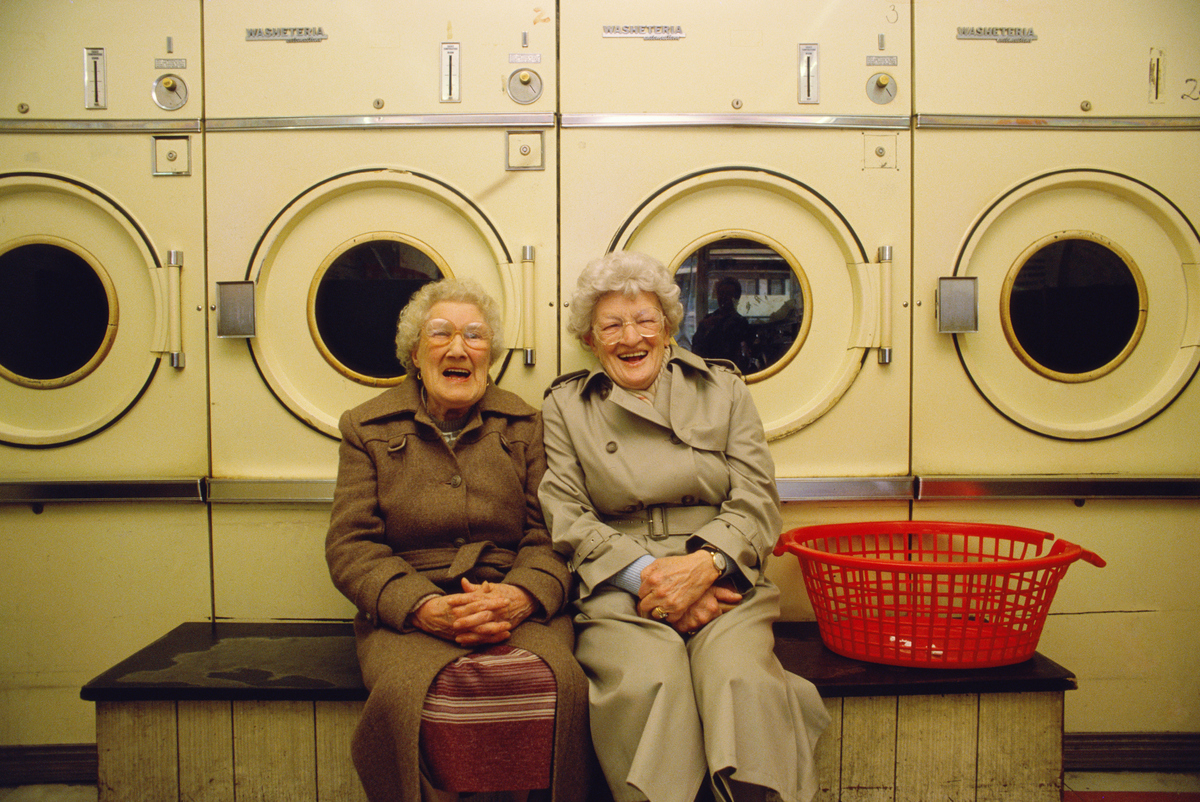 senior women laughing in launderettes