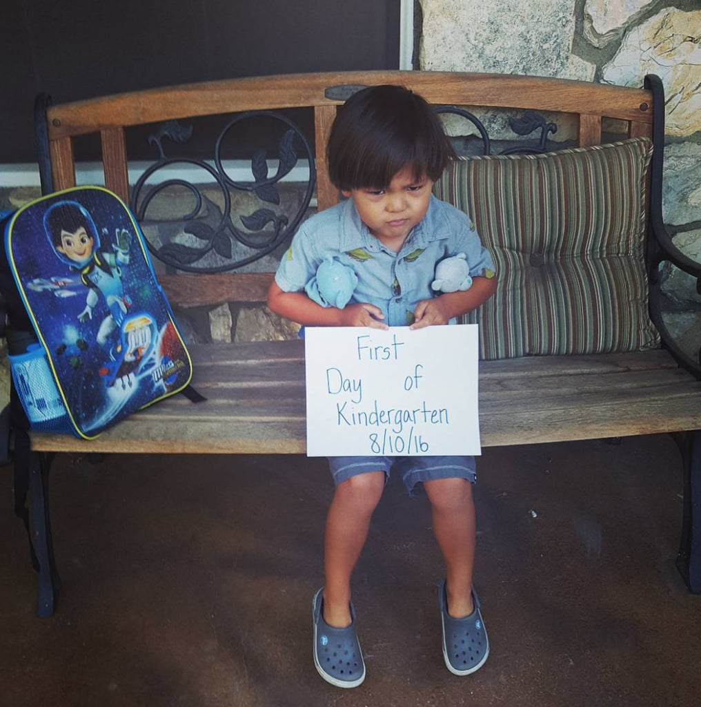 kindergarten boy looking frustrated and holding a sign that says
