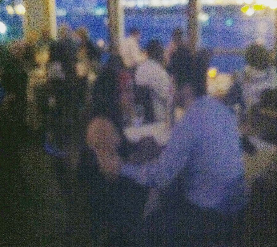 man proposes to girlfriend blurry restaurant photo