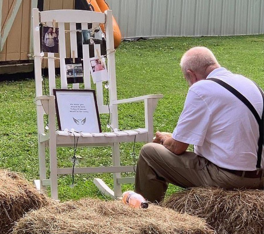 grandfather sitting eating with memorial to grandmother at wedding