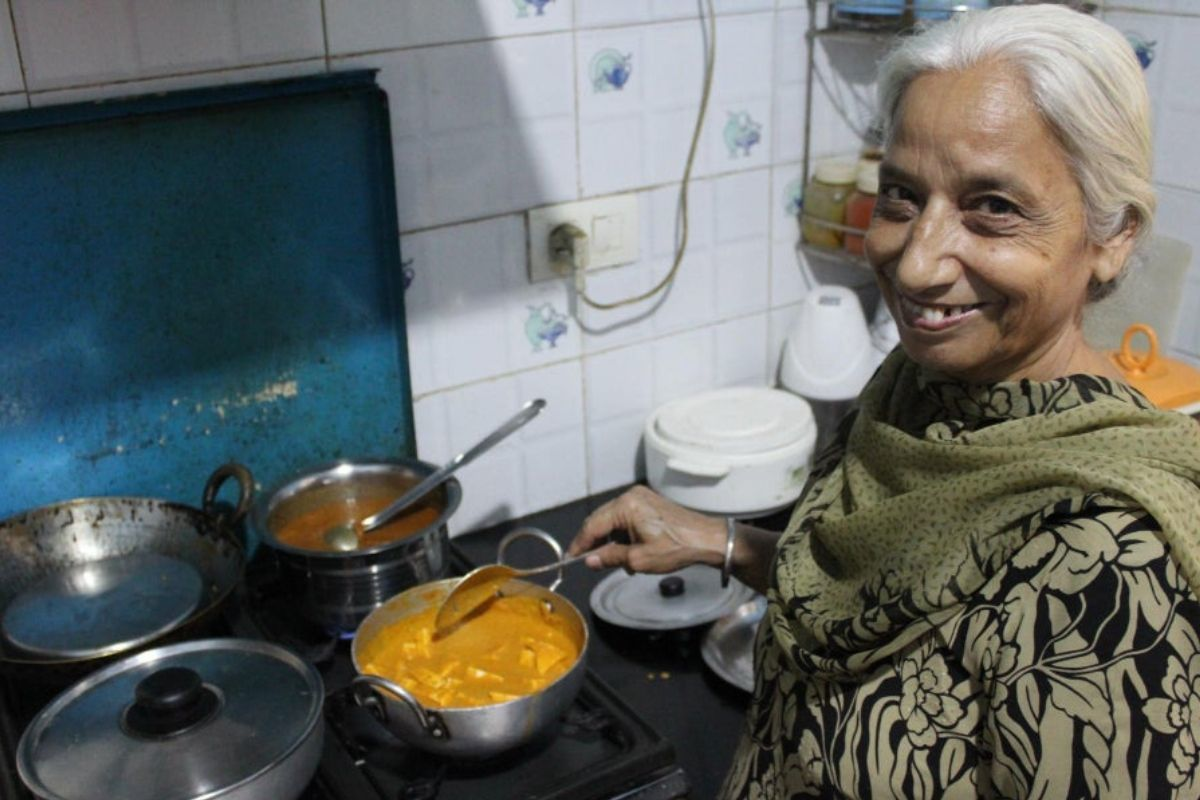 grandma cooking meal smiling