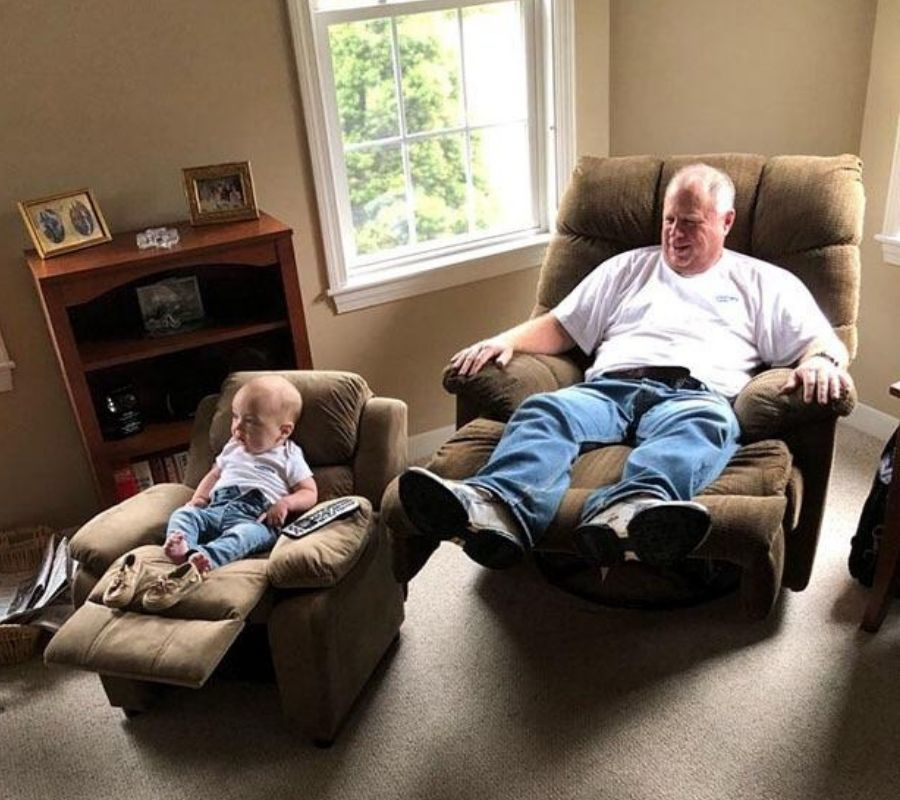 baby and grandfather reclining in chairs together matchign chairs and outfits