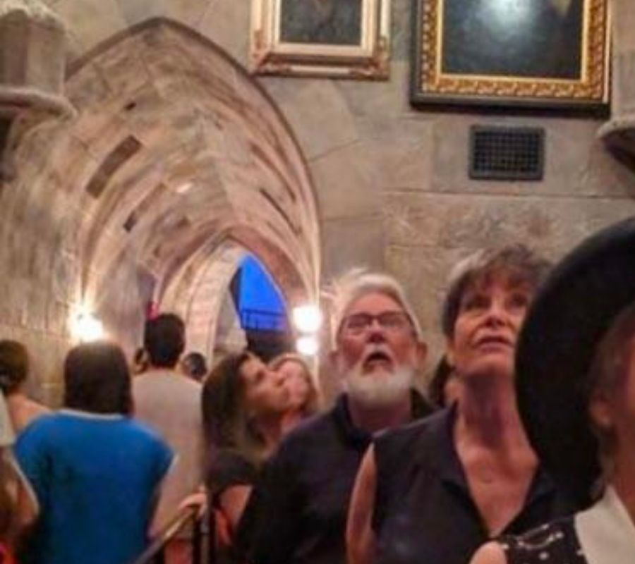 grandfather at harry potter world super happy staring up at the ceiling