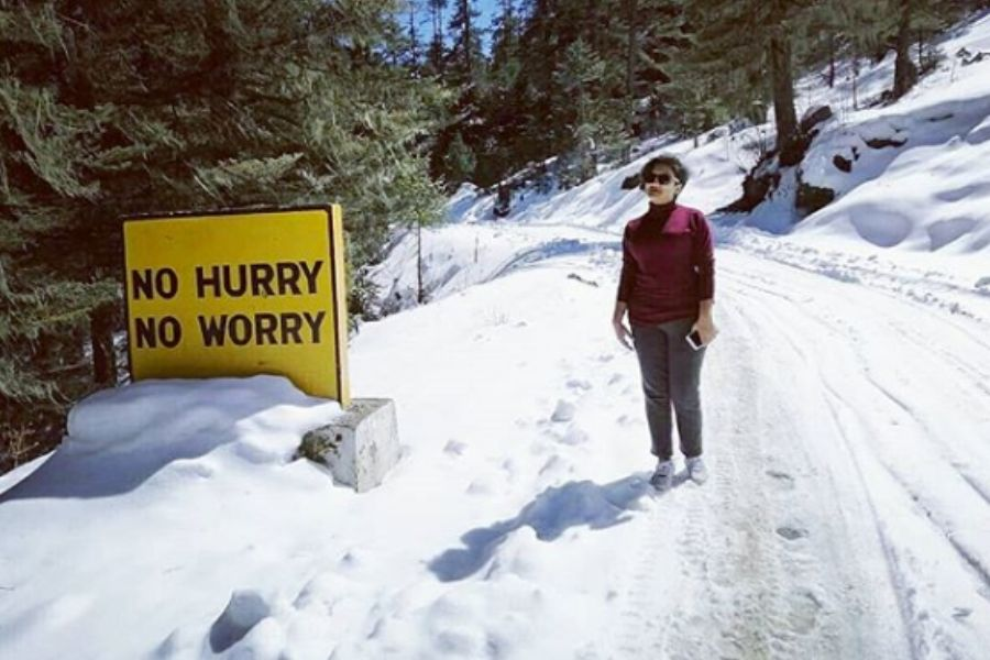 no hurry no worry sign and hiker