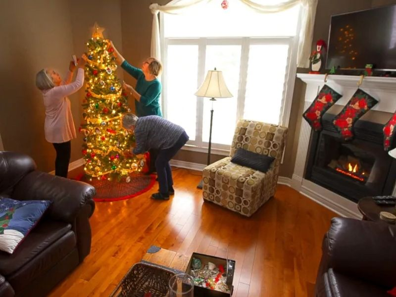 barb, phyllis, mary decorating christmas tree