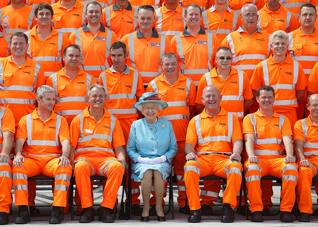 Queen Elizabeth II poses for a group photograph with Network Rail construction workers after opening the newly redeveloped Reading Railway Station