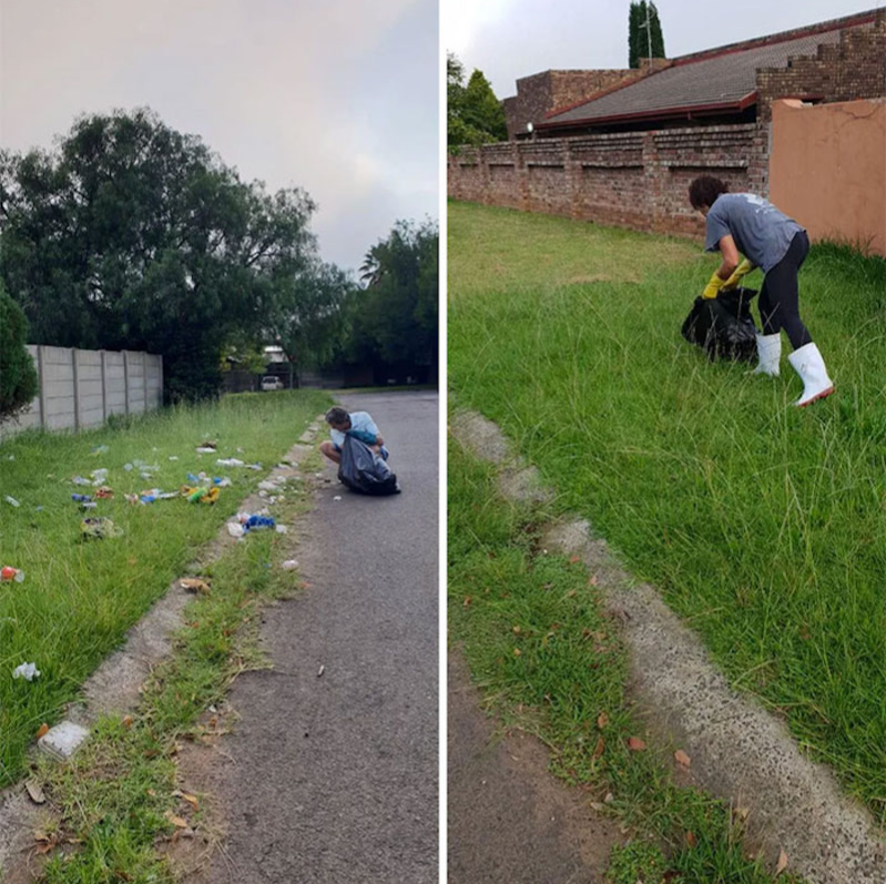 guy cleaning garbage off grass