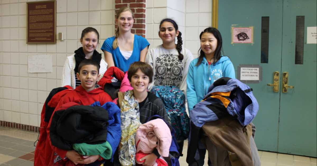 kids holding coats for a fundrasier