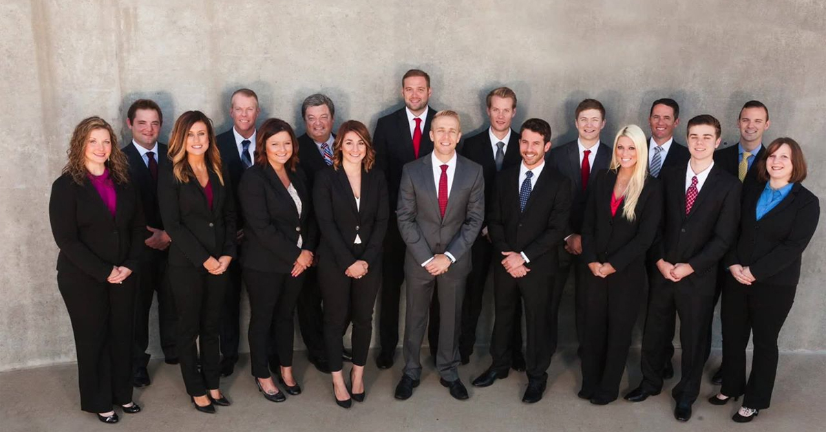 people dressed in business attire posing for a photo