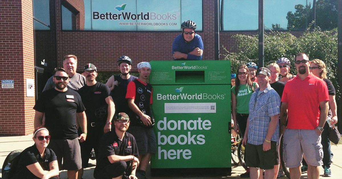 a crowd gathered around a book drop-off box