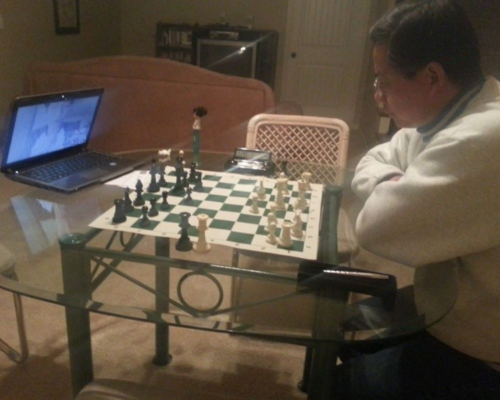 dad plays boyfriend in chess over the computer