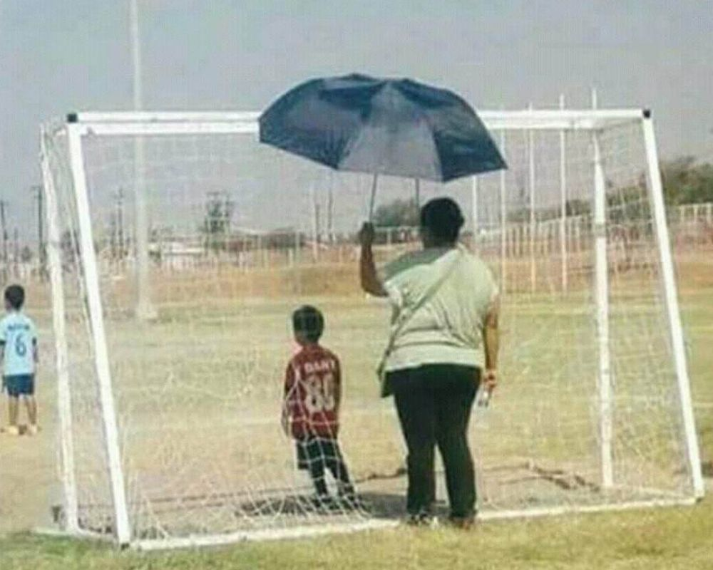 mom umbrella soccer