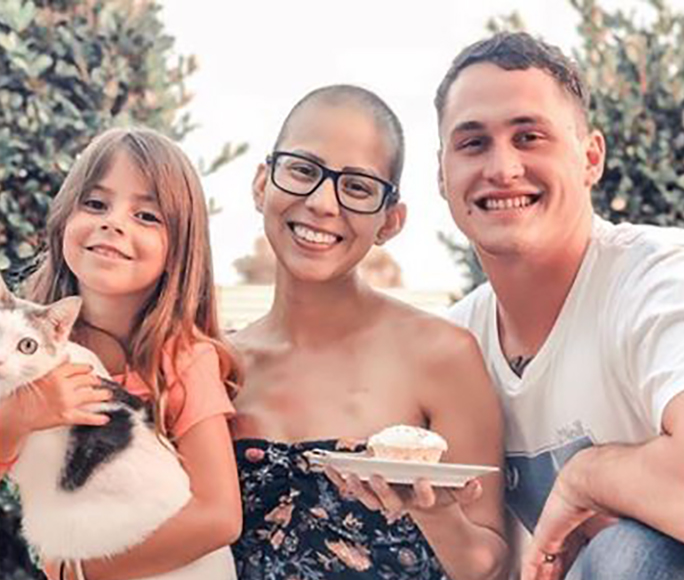 Alexis celebrates her 31st birthday cancer-free with her daughter and husband