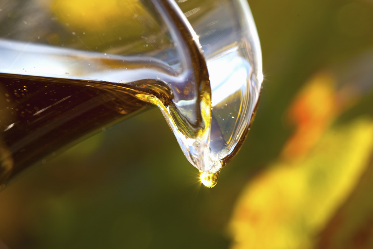 Pouring grapeseed oil close up