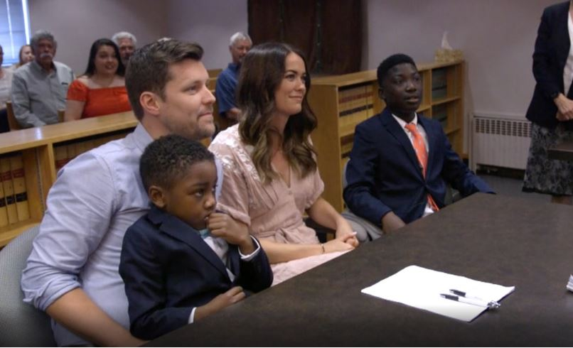 Sara and Stuart Shank sit in court with their foster kids, Michael and Dayshawn