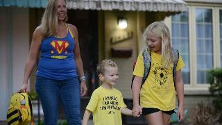 Whitaker Weinburger and his sister Lakeland and his mother Erin Weinburger leave their family home early morning in Alexandria, VA, to see more than 100 yellow cars lined up in the street