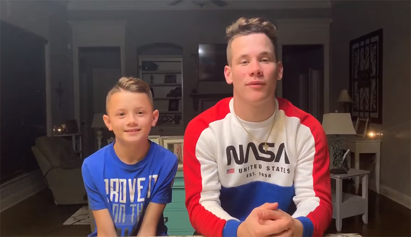 Max and Noah sit in their house and film themselves saying thank you