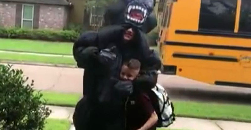 Noah gives a thumbs up through his inflattable gorilla costume while squeezing his arm around Max