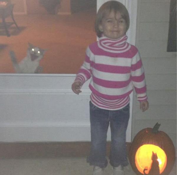 funny-kid-Halloween-pumpkin-cat-smiling-76579