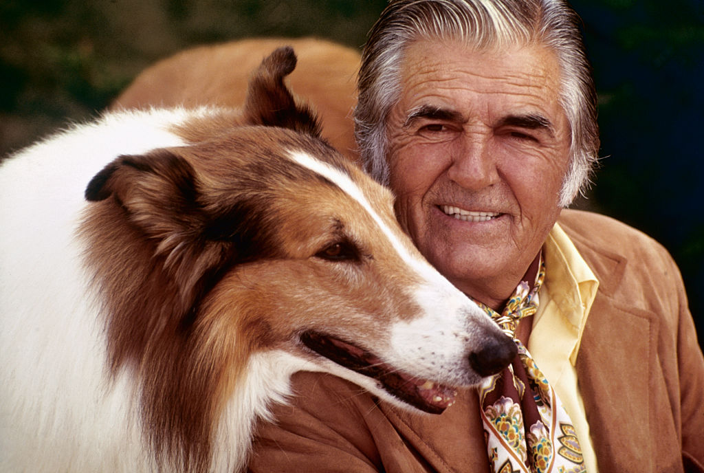 lassie posed with owner and trainer, rudd weatherwax