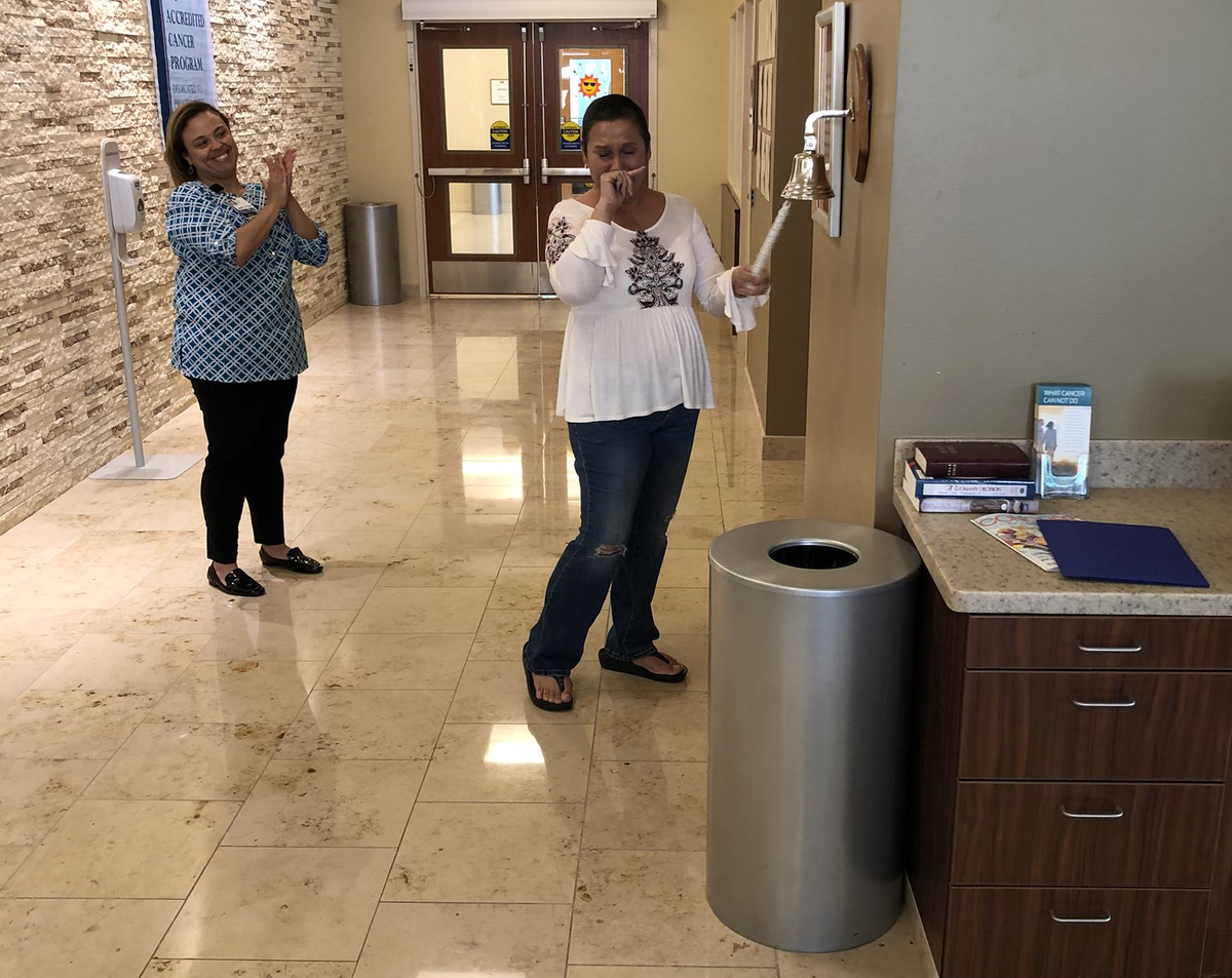 Diana Ruiz rings the bell after learning that she's cancer-free